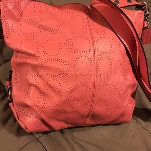 Blush /pink perforated Coach purse